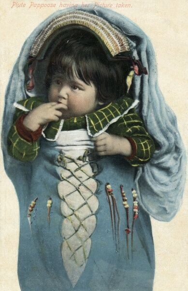Indigenous Americans Baby in a decorated papoose Date: circa 1910