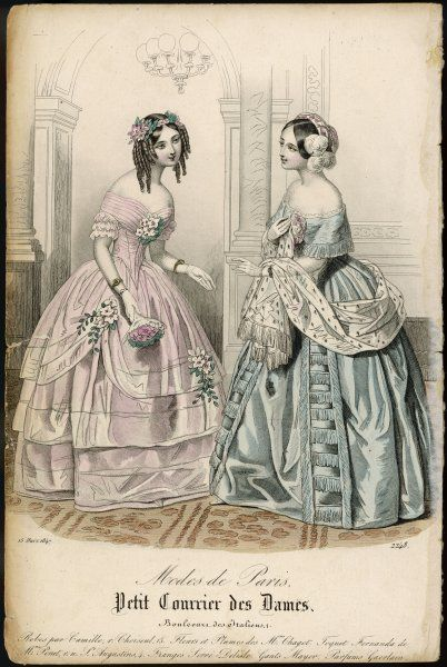 Two ladies in indoor dresses at a reception