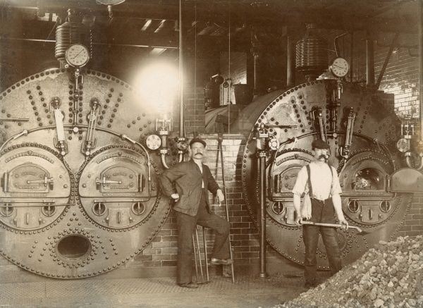 Workmen in front of two Meldrum Brothers patent furnaces, manufactured in Manchester