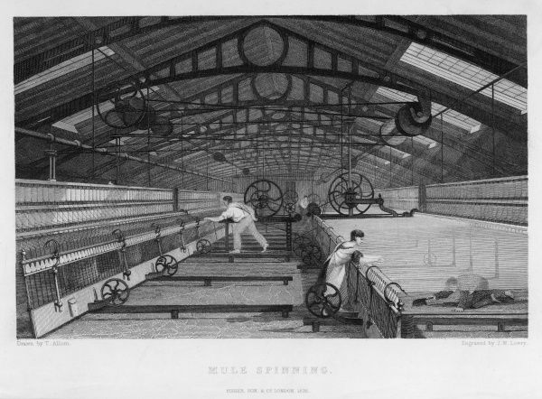 Interior of cotton factory: mule spinning, Lancashire, child sweeps inside moving machine