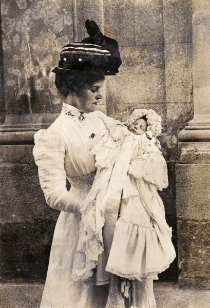 The first photograph of the Infanta Beatriz of Spain, seen here with an English nurse in the gardens of the Royal Palace of La Granja de San Ildefonso, the Spanish royal family's summer residence near Segovia
