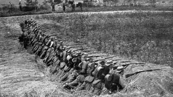 German infantry firing from a trench during training exercises. The trenches would become the characteristic feature of World War I stalemate warfare