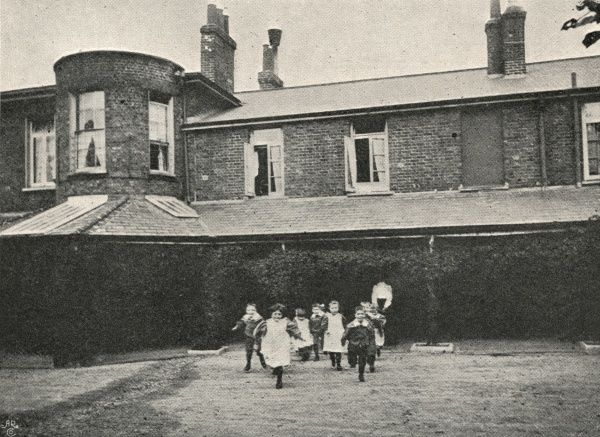 Infants (girls and boys together) at play at the Lambeth Schools for workhouse children on Elder Road, West Norwood, South London. A young Charlie Chaplin was briefly a resident of the Schools in 1898