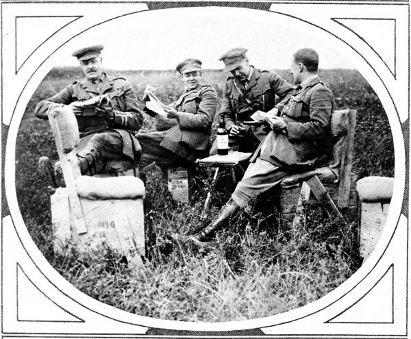 A group of British officers of a moter machine-gun battery are pictured relaxing upon chairs made from empty ration boxes