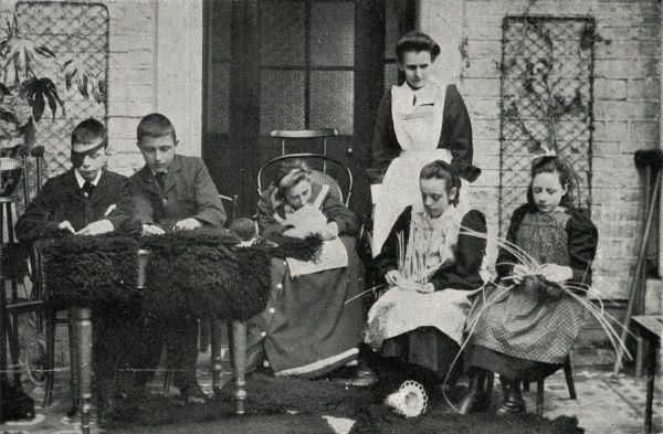 The National Children's Homes (NCH) home at Chipping Norton in Oxfordshire, opened in 1903 for what were described as 'delicate and affected children'. Here, inmates with various physical disabilities are making baskets and rugs