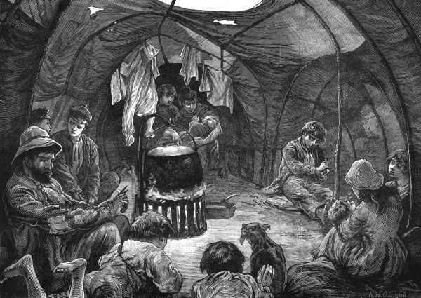Inside a tent on Mitcham Common, the home to two men, their wives, and fourteen children of various ages