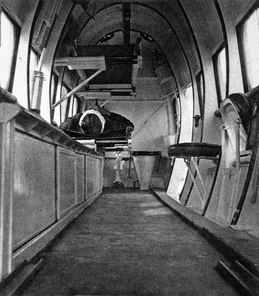 A photograph of a patient on a stretcher, with another stretcher above. The interior of the spacious cabin of a Vickers ' Vimy' aeroplane equipped for medical purposes