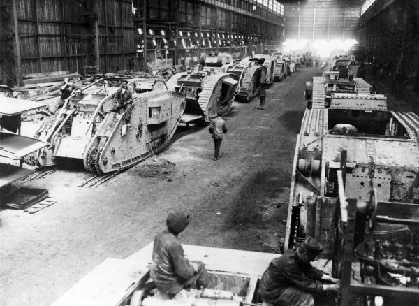 View inside a tank repairing workshop during the First World War, containing a large number of captured British tanks. Date: September 1918