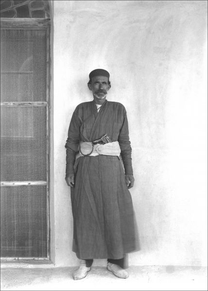 An Iranian man with a gun tucked into his belt, Bushehr (Bushire), Iran. At the time of this photograph the city had been under British occupation for five years. Photograph by Ralph Ponsonby Watts