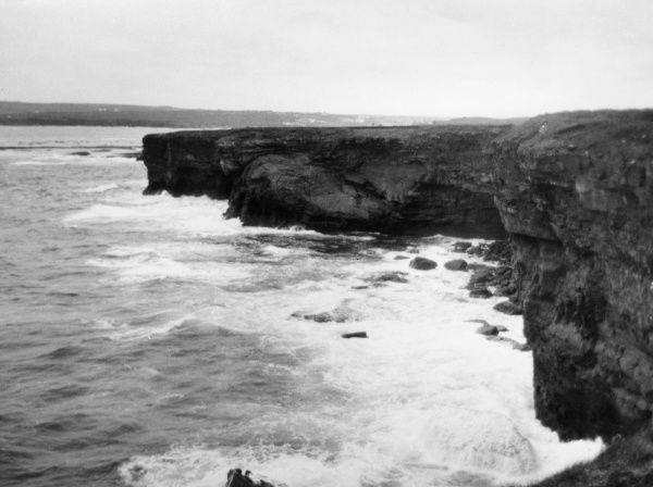 The rocky coast of Kilkee, County Clare, Ireland, showing the Lion's Head. Date: 1930s