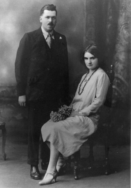 A studio photograph of a bride and groom, Ireland. Date: 1920s