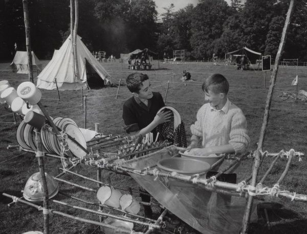 Two Scouts of the Catholic Boy Scouts of Ireland washing up in camp. The wash stand cum dresser has been built by them out of the natural materials available on the campsite. 1966
