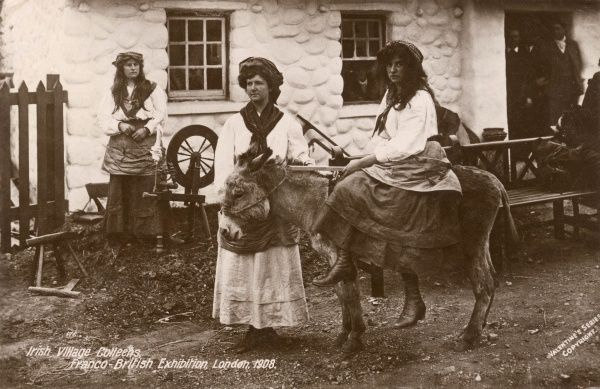 Three Irish Village Colleens with a donkey and a spinning wheel at the Franco-British Exhibition, held at White City, West London. Date: 1908