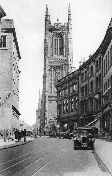 View of Irongate, in the centre of Derby, dominated by the Cathedral (All Saints). Tramlines can be seen in the road surface. Date: circa 1910