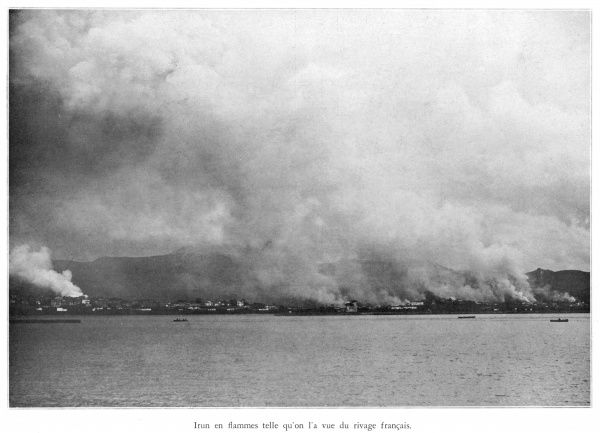 Irun in flames, seen from the French shore