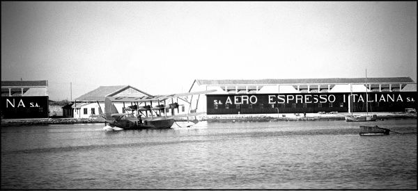 View of an Italian Airmail Warehouse (Aero Espresso Italiana) with a British seaplane. Photograph by Ralph Ponsonby Watts