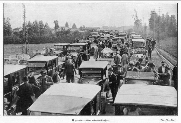 Italian motorists crowd onto the first autostrada in a 'grand automobolist cortege', closely resembling a traffic jam