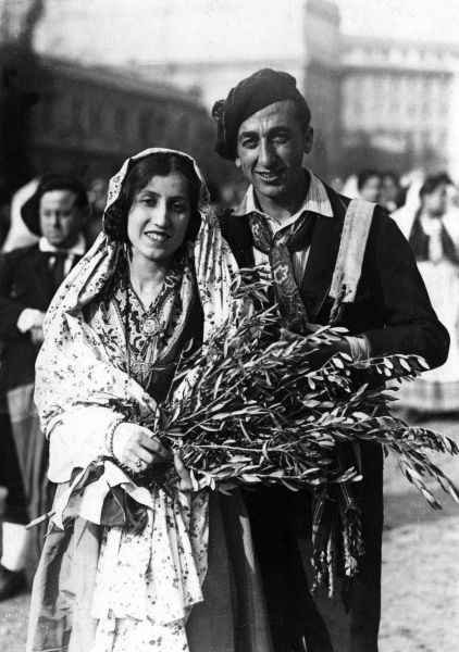 A happy bride and groom of Pavona, Italy, wearing traditional costume. Date: 1930s