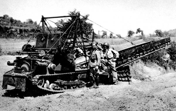 Photograph showing an Italian Army tank, which carried and laid a metal bridge, taking part in manoevres near Naples, 1936. Machines such as this were used by both sides in World War II to create bridges across small obstacles, such as rivers