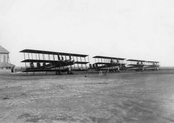 Four Italian Caproni Ca.4 heavy bomber planes, used during the First World War and later. It was a three-engine twin-boom triplane constructed in wood and covered with fabric. Seen here on an airfield. Date: circa 1917-1918