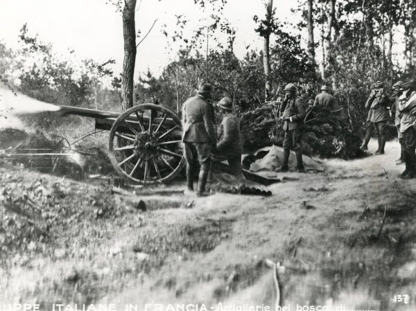 Italian gunners with a 75 mm battery in action in a wood near Rheims, north eastern France, during the First World War. Date: July 1918