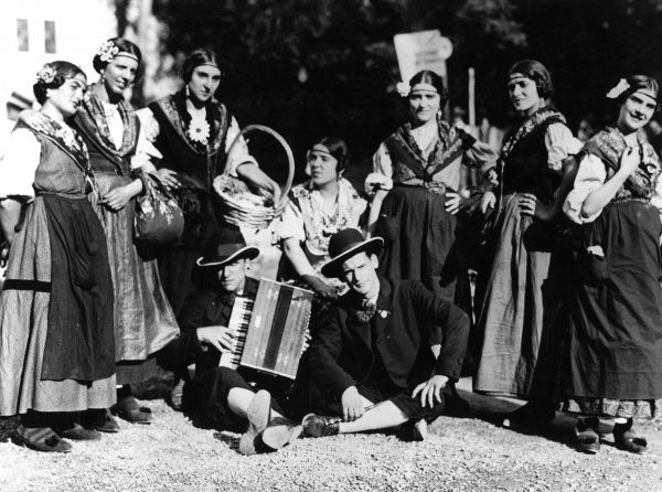Italian peasants in their traditional harvest festival costumes. Date: 1930s
