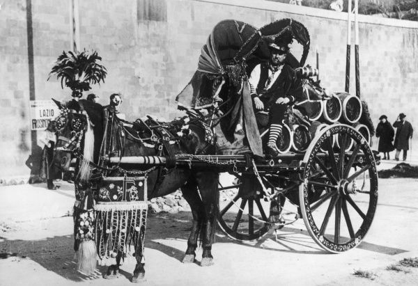 An Italian wine merchant (note his stripy socks!), his pony and cart being highly decorated for the Lazio Festa (annual festival)