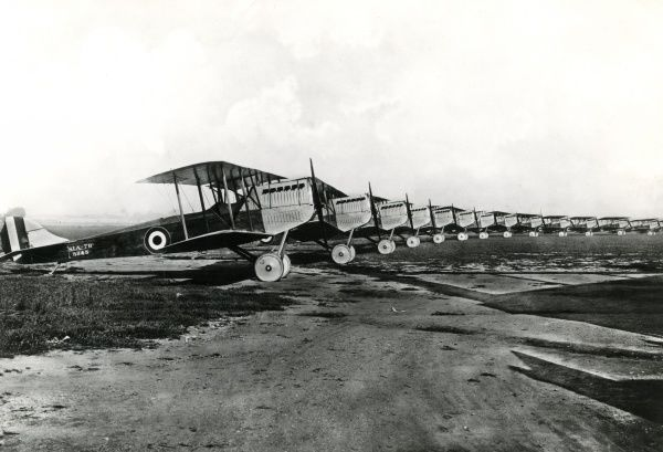 A long row of Italian SIA 7B1 biplane reconnaissance bombers with Fiat A12 engines, standing on an airfield during the First World War. Date: 1917
