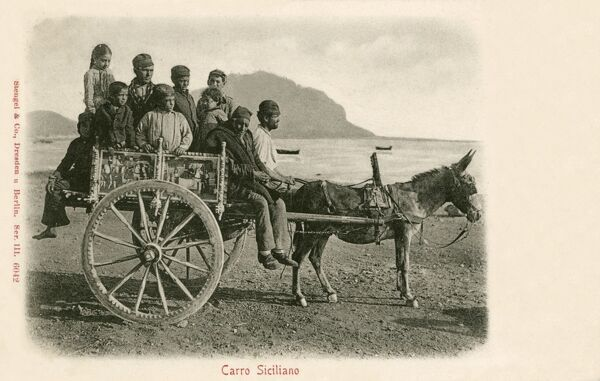 Italy - A beautifully decorated Sicilian Donkey Wagon (Carro) with a load of children!