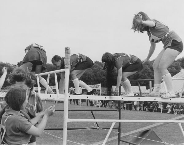 Girls taking part in an 'It's A Knockout' style sporting competition. Date: late 1960s
