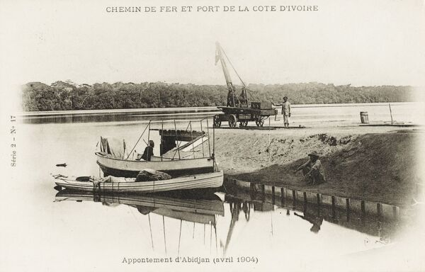 River crossing at Abidjan, Ivory Coast with a railway carriage crane, ready to unload arriving cargo