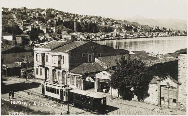 A suburb of Izmir (Smyrne), Turkey with an electric tram in the foreground