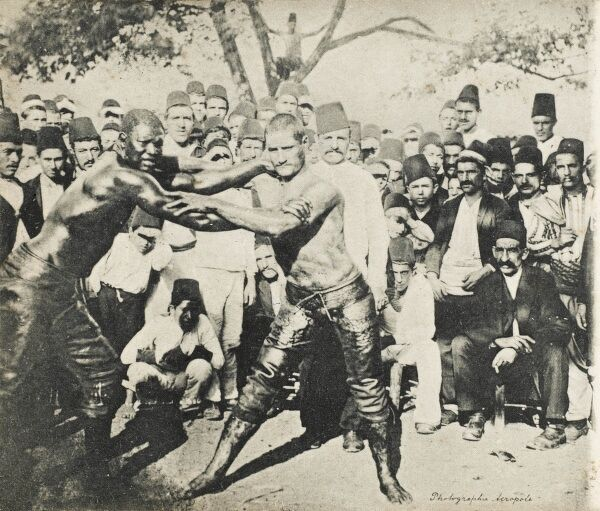 A wrestling match between African and a Turkish professional wrestlers at Izmir (Smyrna), Turkey - posted from the Russian Post office to Lyon from Smyrna by a French tourist! Yagli gures (Turkish wrestling) is the Turkish national sport