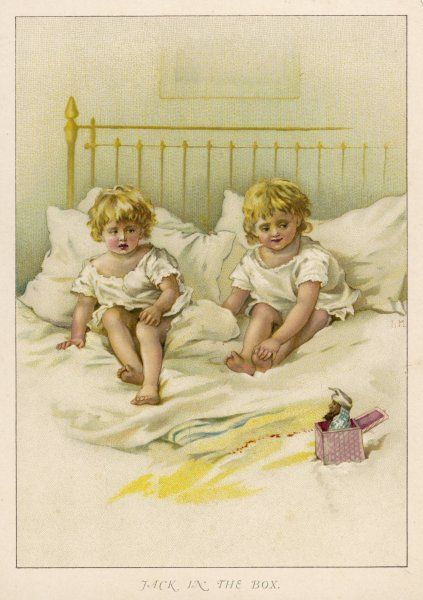 Two children look warily at a jack-in-the-box sitting on their bed