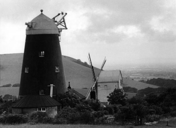 Two landmark windmills, known as 'Jack and Jill', at Clayton, Sussex. 'Jack' is the tall black tower mill and 'Jill', built in Brighton in 1821, was dragged here by oxen. Date: early 19th century