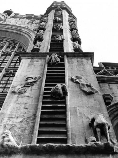 'Jacob's Ladder' depicted on each turret, with angels descending head first, on the West Front of Bath Abbey, Somerset, England. Date: 12th century