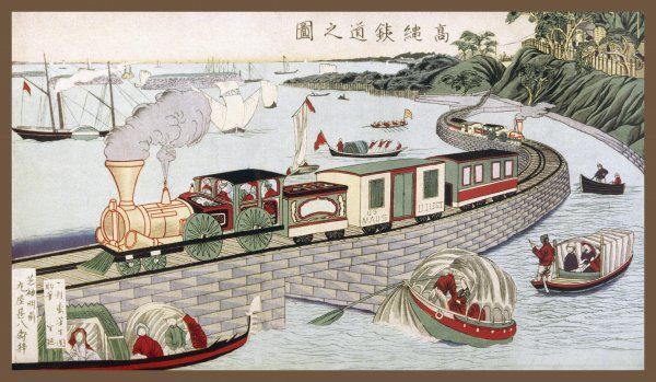 A picturesque scene on the Takanawa Line, where the track goes out across the water on a gently curving causeway pierced by arches so that small boats can pass through