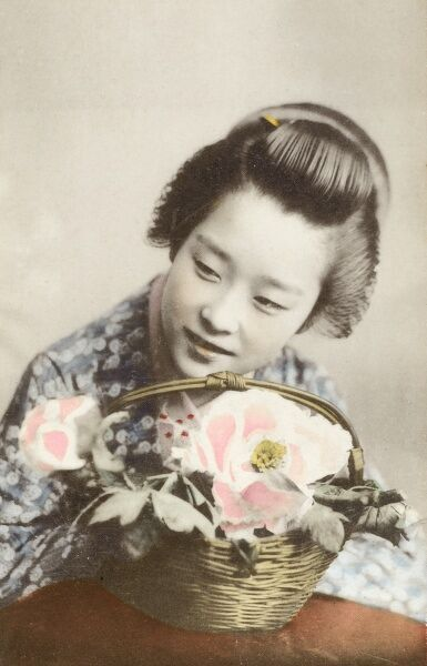 Young geisha girl with a basket of flowers. Date: circa 1910s