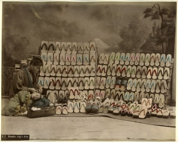 A man selling wooden footwear known as geta in Japan