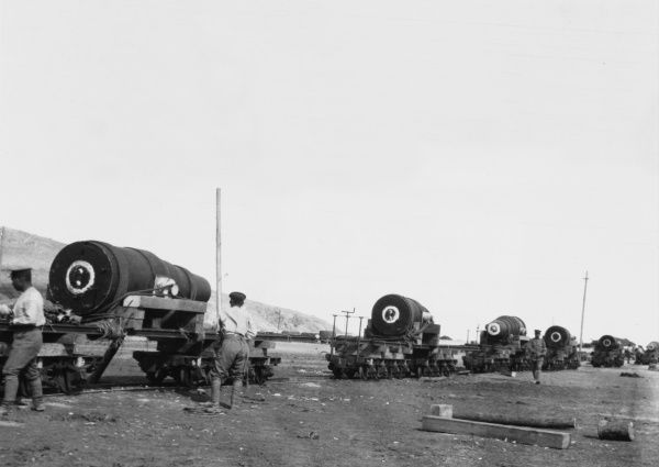 Japanese 11-inch howitzers loaded on railway trucks ready to be transported to a forward area