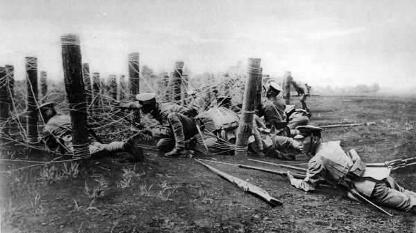 Japanese Infantry negotiating a wire entanglement