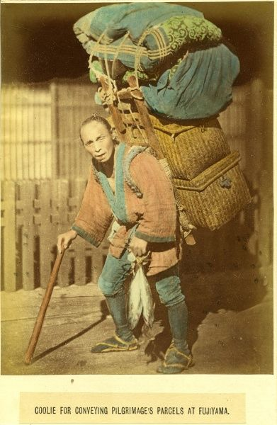 A Japanese coolie carries the luggage and belongings of pilgrims at Fujiyama