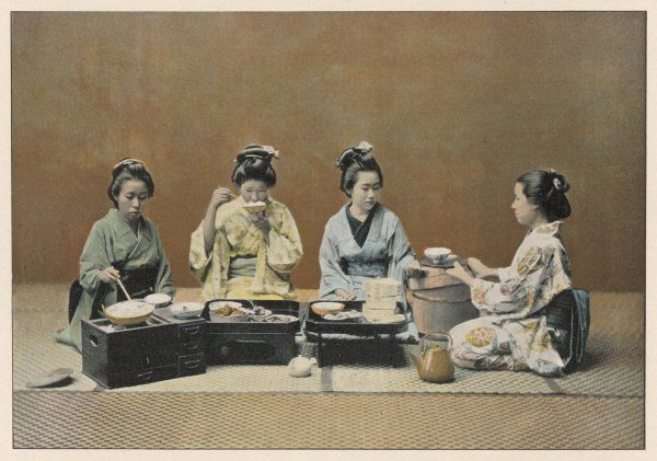 Japanese women in traditional costume eat together