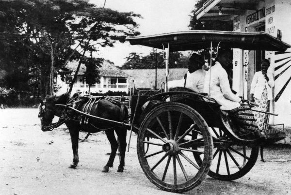A horse taxi cab, Java, Dutch East Indes (Indonesia). Date: 1930s