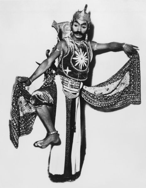 A male dancer of Java, Indonesia. Date: 1930s