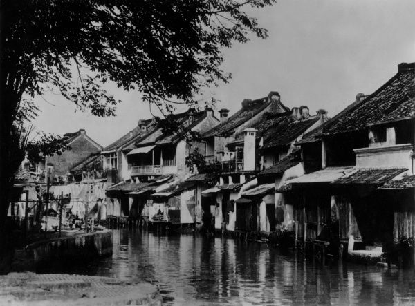 Riverside slum dwellings in the old town, Batavia, Java, Indonesia. Date: 1930s