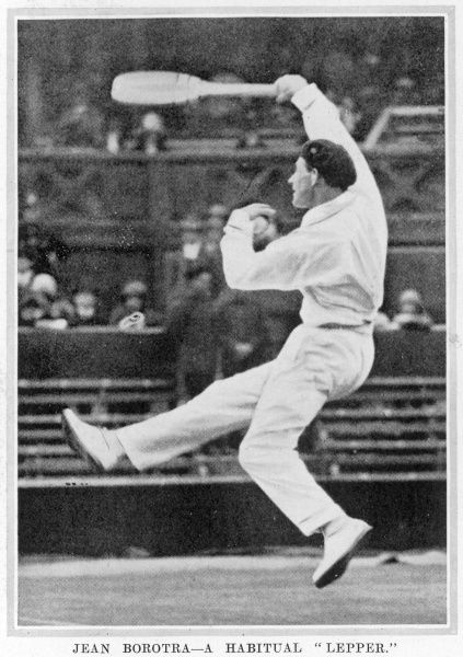 Jean Borotra (1898 - 1994), French tennis player known as the 'Bounding Basque), pictured at Wimbledon in action and wearing his signature beret