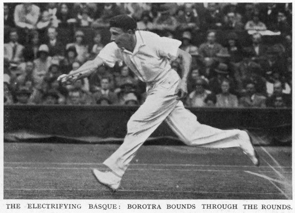 Jean Borotra (1898-1994), French tennis player known as the 'Bounding Basque' (although the Illustrated Sporting and Dramatic News describes him here as the 'electrifying Basque'), pictured here in action during a match at Wimbledon