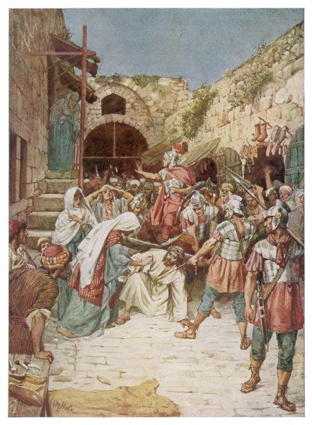 Jesus carries his cross through the streets of Jerusalem