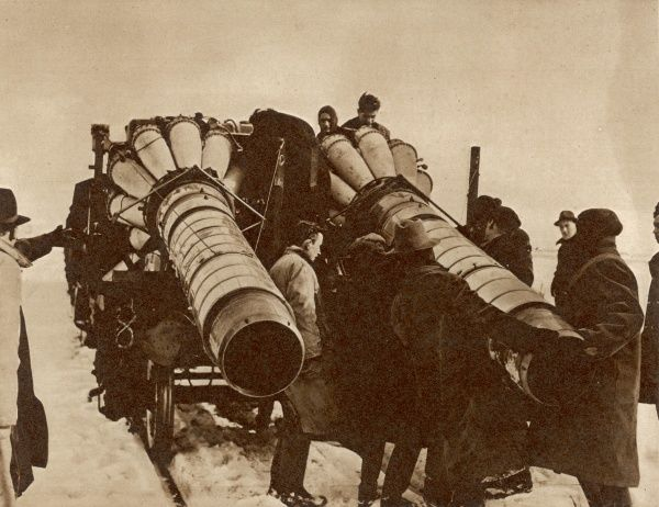 Men engaged in fitting jet units to the rear of a wagon on a snow encrusted stretch of line near Brecon, an ingenious way of clearing the disabling snow drifts preventing trains carrying coal on the Welsh railways during the winter of 1947